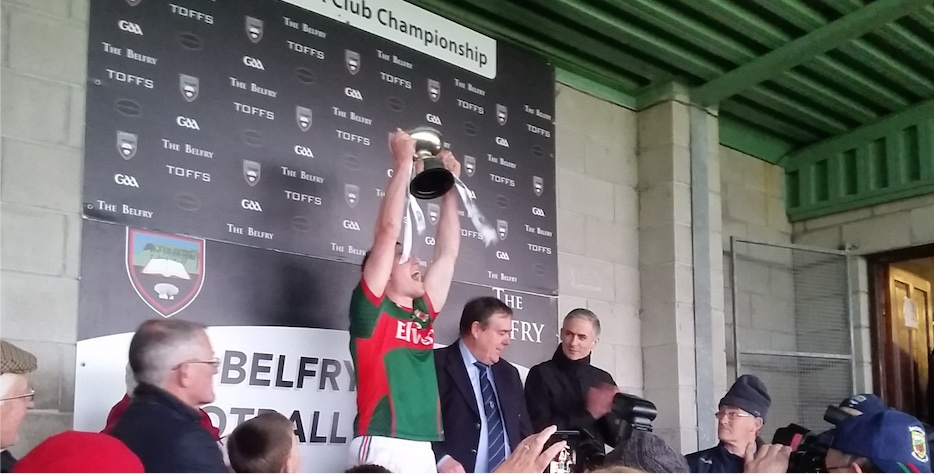 Stephen Coen lifts the Cup